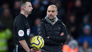 Pep Guardiola (R) with referee Michael Oliver