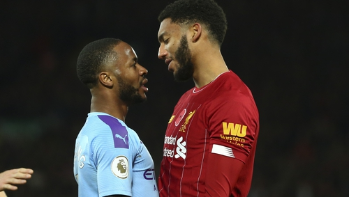 Raheem Sterling (L) and Joe Gomez square up to each other at Anfield