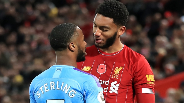 Liverpool's Joe Gomez and Manchester City's Raheem Sterling