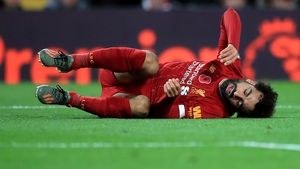 Mohamed Salah appeared to injure his left ankle in Liverpool's win over Manchester City on Sunday