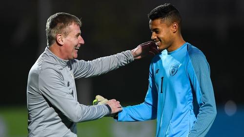 Stephen Kenny embraces Gavin Bazunu after the 1-0 win over Armenia