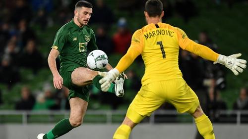 Stefan Marinovic faces down Troy Parrott at the Aviva
