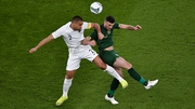 Troy Parrott and Winston Reid compete for the ball