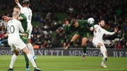 Callum Robinson heads home Ireland's third goal of the night