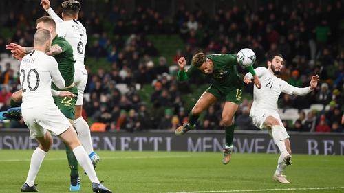 Callum Robinson heads home Ireland's third goal of the night
