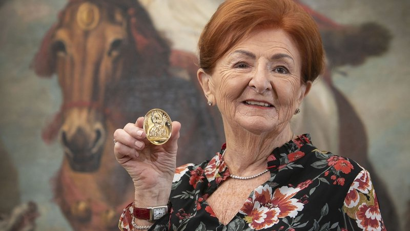 Breege         O'Donoghue (pictured here with a gold medal for enterprise in         2019) has resigned from the board of Fáilte Ireland