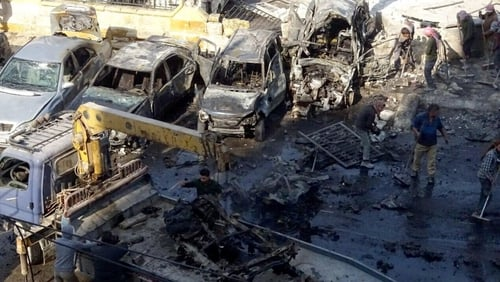 The bomb, which struck a bus and taxi station in the town, also wounded 33 people