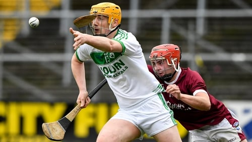 Eoin Reid of Ballyhale Shamrocks in action against Eoin O'Leary of St Martin's