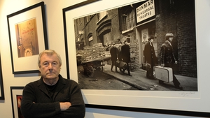 Terry O'Neill photographed with one of his Rolling Stones images in New York in May 2012