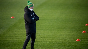 Mick McCarthy looks on as his squad train the day before 'the big game'