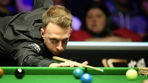 Judd Trump compiled breaks of 85 and 114 on his way to setting up a last 16 clash with Luca Brecel