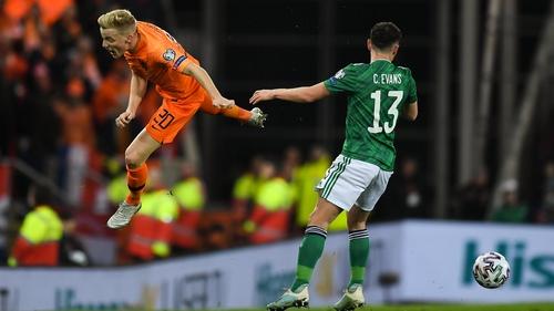 Donny van de Beek of the Netherlands in action against Corry Evans