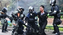 A protester is detained by police near the Hong Kong Polytechnic University