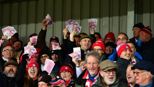 Gloucester fans wave fake money during their recent Premiership meeting with Saracens