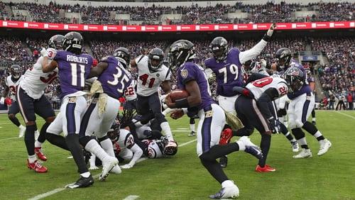 Quarterback Lamar Jackson rushes for the Ravens