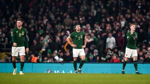 Alan Browne, Enda Stevens and James McClean react at the full-time whistle against Denmark