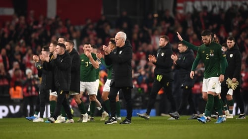 Mick McCarthy and his players applaud the fans after the draw with Denmark