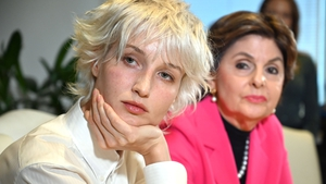Jane Doe 15 (L) appeared at a news conference with her lawyer Gloria Allred