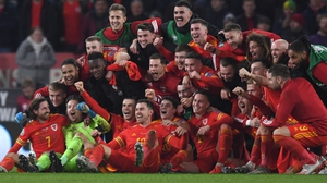 Wales players celebrate qualification after victory over Hungary
