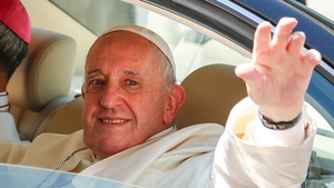 Pope Francis waves to crowds after his arrival in Thailand