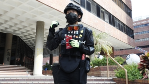 A protester is seen wearing a vest of fire lighters in Hong Kong Polytechnic University