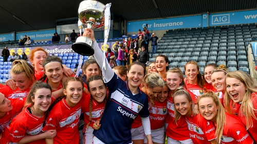 Cork captain Martina O'Brien and her team-mates celebrate with the cup after their league final victory
