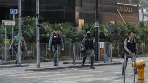 Police patrol an area outside the Hong Kong Polytechnic University