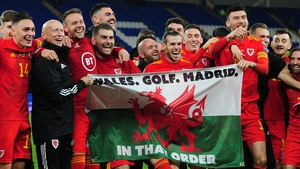Gareth Bale and his Wales team-mate celebrate with the flag