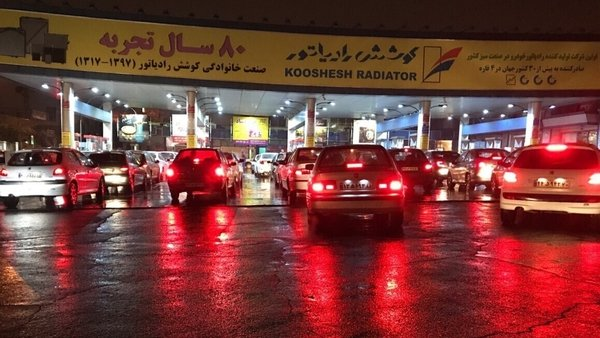 Cars at a petrol station in Tehran as protests continue after the Iranian government imposed fuel rationing and raised prices. Photo: Muhammet Kursun/ Anadolu Agency via Getty Images