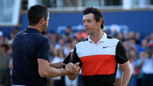 Rory McIlroy shakes hands with his playing partner Mike Lorenzo-Vera of France