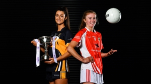 Eimear Meaney of Mourneabbey (L) and Louise Ward, captain of Kilkerrin-Clonberne, with the Dolores Tyrrell Memorial Cup