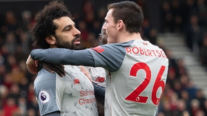 Mo Salah (L) and Andy Robertson