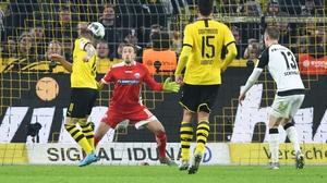 Reus heads the late equaliser for Dortmund