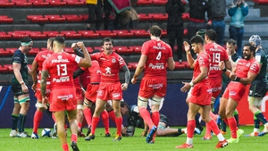 Toulouse players celebrate the late try to seal the bonus point