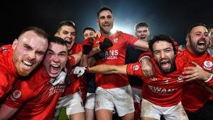 Éire Óg players celebrate their victory over Portlaoise