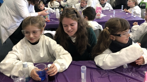 Alice Shaughnessy from Calasanctius College Oranmore with primary school children at a chemistry workshop