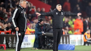 Manchester United manager Ole Gunnar Solskjaer (R) and Sheffield United boss Chris Wilder on the touchline
