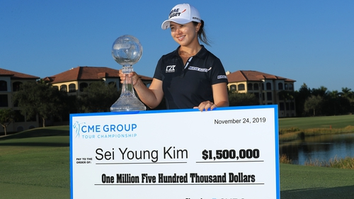 Sei Young Kim celebrates with the trophy and that cheque