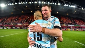 Donnacha Ryan embraces Racing 92 team-mate Simon Zebo after the thriller at Thomond Park