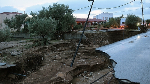 Torrential rains left damages in the town of Kineta, some 50 km southwest of Athens