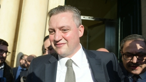Maltese Tourism Minister Konrad Mizzi leaves the office ofPrime Minister Joseph Muscat after announcing his resignation