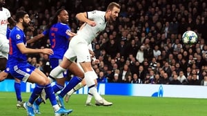 Harry Kane heads home his side's fourth goal