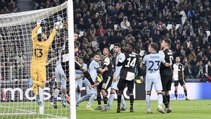 Paulo Dybala of Juventus scores from a near impossible angle