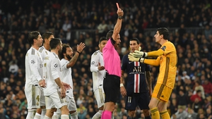 Thibaut Courtois is shown a red card that was later rescinded