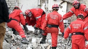 Emergency crews, helped by international rescuers were working through the night to search through the wreckage