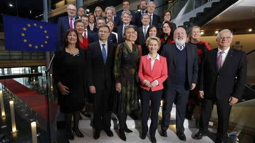 The new commission led by Ursula von der Leyen (C) takes up office on 1 December