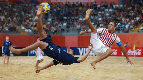 Gabriel Silveira of USA competes for the ball with Pedro Moran of Paraguay