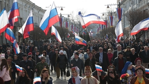 People carry Russian flags during celebrations of the fifth anniversary of Russia's annexation of Crimea in Simferopol earlier this year