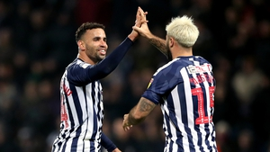 West Bromwich Albion's Charlie Austin (right) celebrates scoring his side's fourth goal of the game with team mate Hal Robson-Kanu