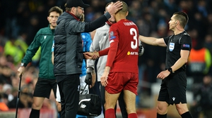 Jurgen Klopp consoles the stricken Fabinho at Anfield